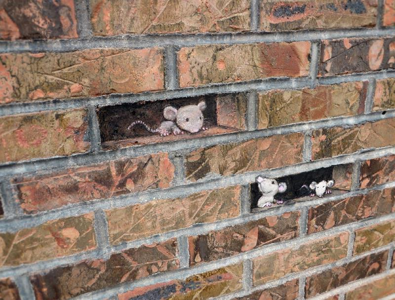 Trompe-loeil-missing-bricks-illusion-street-art-by-David-Zinn.jpg