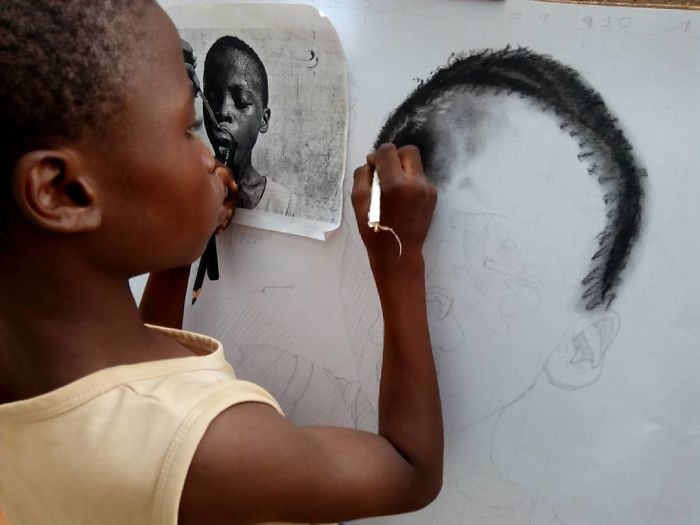 At-11-years-old-boy-makes-hyperrealistic-drawings-that-will-impress-him-5b3c041f6d482__700.jpg